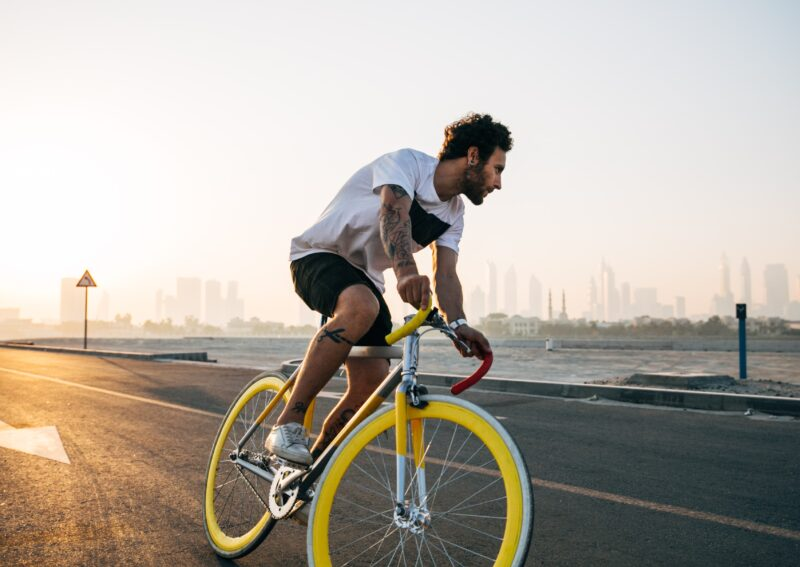 An image of a man riding a bicycle